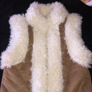 Super cute and fuzzy Old Navy vest. Size XS